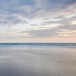 Long exposure seascape with soft tones and calm sea