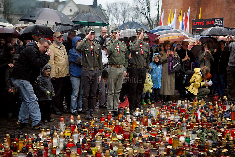 Polish Scouts salute as they change guards Sunday at the Katyn memorial near Wawel Castle in Krakow. Krakovians gathered there to light candles and honor their fallen president. Polish President Lech Kaczynski and many of the country's top leaders were killed in a plane crash Saturday morning on route to the site of a Soviet massacre of Polish officers during World War II. . April 10, 2010