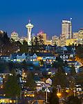 Seattle, Washington<br /> Night view of the city skyline and hillside homes of the Magnolia neighborhood