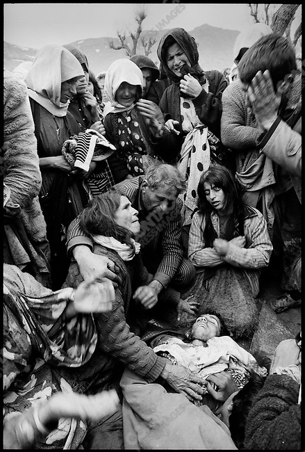 Aftermath of the Gulf War, an Iraqi Kurd family in the Isikveren refugee camp, just inside the Turkish border, mourns a man shot and killed by Turkish soldiers in a melee that occurred upon the arrival of relief supplies.<br />Turkey, April 1991