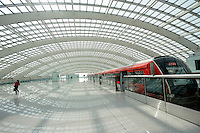 Airport Express Train Station at the Terminal 3 Beijing Capital International Airport. Designed by British architect Lord Norman Foster, the new terminal is the world's largest airport building.<br /> <br /> Lou Linwei / Sinopix