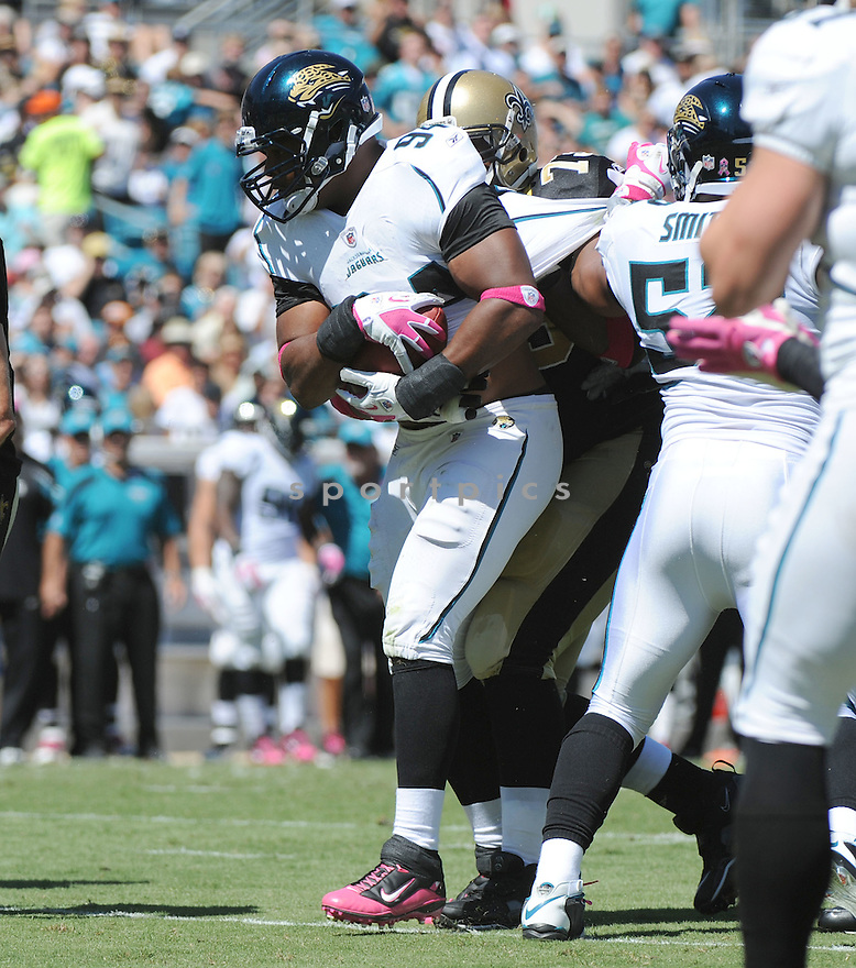JEREMY MINCEY, of the Jacksonville Jaguars, in action during the Jaguars game against the New Orleans Saints on October 2, 2011 at EverBank Field in Jacksonville, FL. The Saints beat the Jaguars 23-10.