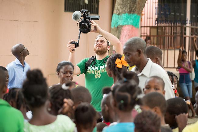 June 23, 2015; Ryan Blaske shoots in Haiti. (Photo by Matt Cashore/University of Notre Dame)
