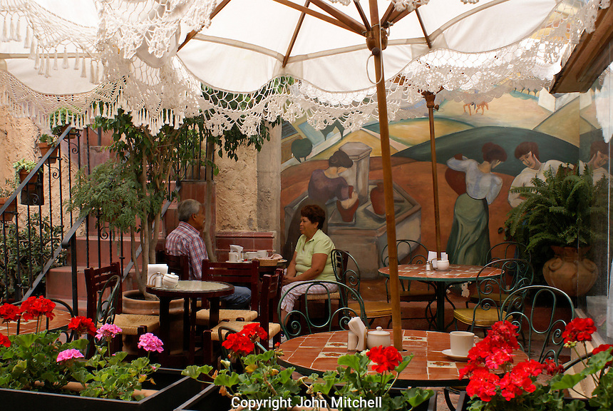 Middle aged Mexican couple talking in an outdoor restaurant cafe in San Miguel de Allende, Mexico