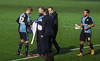 A Goalkeeper shirt is handed to Jason McCarthy of Wycombe Wanderers as he stands in for sent off Goalkeeper Matt Ingram of Wycombe Wanderers during the Sky Bet League 2 match between Wycombe Wanderers and Morecambe at Adams Park, High Wycombe, England on 2 January 2016. Photo by Kevin Prescod / PRiME Media Images