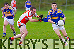 Quarter Final Replay of The Bernard O'Callaghan Memorial Senior Football Championship 2014 sponsored by McMunns, Ballybunion, Saturday 20th December 2014 in Duagh, Brosna VS St.Senan's<br /> <br /> St. Senan's Padraig Quill being pulled back by Brosna's Peter Quinn.