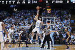 CHAPEL HILL, NC - FEBRUARY 12: Notre Dame's Martinas Geben (LTU) (23) wins the opening tip against North Carolina's Luke Maye (32). The University of North Carolina Tar Heels hosted the University of Notre Dame Fighting Irish on February 12, 2018 at Dean E. Smith Center in Chapel Hill, NC in a Division I men's college basketball game. UNC won the game 83-66.