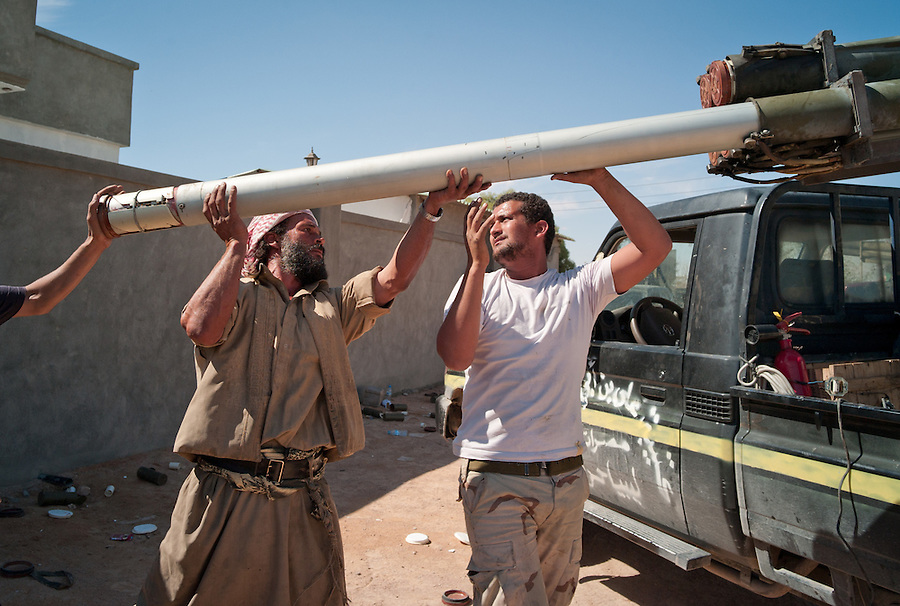 Anti-Gaddafi fighters load Grad rockets to launch towards Gaddafi loyalist positions in Sirte, Libya.