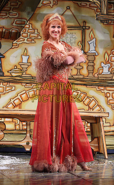ANITA DOBSON.Attending the First Family Entertainment 2009 Pantomime Photocall at the Piccadilly Theatre, London, England, UK, November 19th 2009.full length costume red brown feather boa dress crown panto  fluffy gold beaded .CAP/JIL.©Jill Mayhew/Capital Pictures
