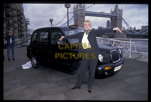 JOANNA LUMLEY .09 October 1997.Ref: 6646.full length, full-length, car.*RAW SCAN- photo will be adjusted for publication*.www.capitalpictures.com.sales@capitalpictures.com.©Capital Pictures