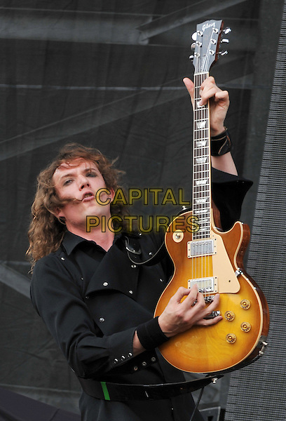"Guitarist DAN HAWKINS of the British glam rock band THE DARKNESS performs at Day 2 of the  'Rock On The Range Festival"" held at Crew Stadium, Columbus, OH., USA..May 20th, 2012             .on stage in concert live gig performance performing music half length black shirt guitar            .CAP/ADM/JN.©Jason L Nelson/AdMedia/Capital Pictures."