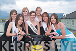 CONGRATUATIONS: Fellow contestants congratulating the  2007 Castlegregory Summer Festival Queen Tracey Slattery on Sunday evening. Seated centre: Irene Ni Cheirin, Carol Fitzgibbon, Tracey O'Donnell, Deirdre O'Connor, Yvonne Keys and Jeniffer Searle..