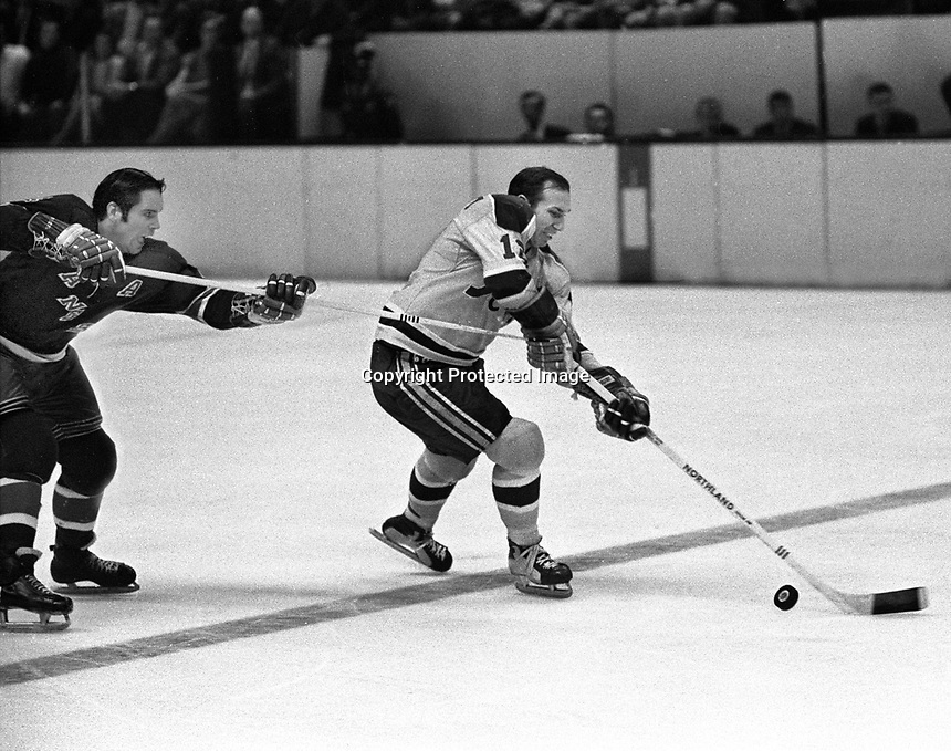 Seals vs. Rangers: Gary Jarrett scates past Ranger Arnie Brown. (1970 photo by Ron Riesterer)