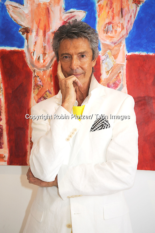 "Tommy Tune in front of his paintings of giraffes at the opening night reception of ""Longnecks"" at the Peter Glebo Gallery on opening night on June 3, 2010 in New York City."