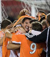 3a4c57acc Houston Dynamo forward Brian Ching (center) celebrates his playoff goal  with teammates. Houston