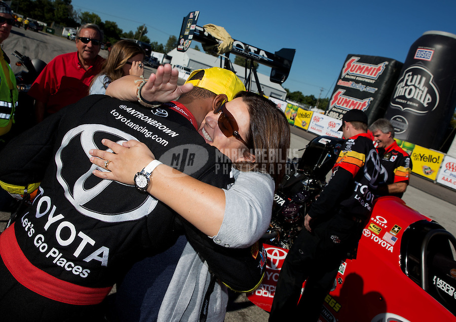 Sep 29, 2013; Madison, IL, USA; NHRA top fuel dragster driver Antron Brown (left) celebrates with wife Billie Brown after winning the Midwest Nationals at Gateway Motorsports Park. Mandatory Credit: Mark J. Rebilas-