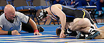 BROOKINGS, SD - JANUARY 11:  Brance Simms from South Dakota State University rolls Chad McCannon from Dakota Wesleyan to his back in their 133 pound match Sunday afternoon at Frost Arena in Brookings. (Photo by Dave Eggen/Inertia)