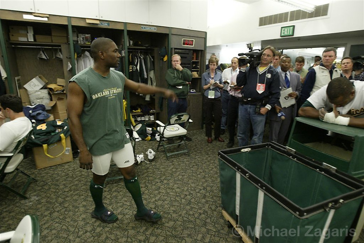 OAKLAND, CA - OCT 5:  Miguel Tejada addresses the press in the clubhouse after the game  at the Network Assoc. Coliseum on Oct 5, 2003 in Oakland, Calif. The Red Sox defeated Oakland 3-1. ..(Photo by Michael Zagaris/MLB Photos)