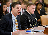 "James Comey, Director of the Federal Bureau of Investigation, left, and Mike Rogers, Director of the National Security Agency, right, give testimony before the United States House Permanent Select Committee on Intelligence (HPSCI) on the ""Russian Active Measures Investigation"" on Capitol Hill in Washington, DC on Monday, March 20, 2017.<br /> Credit: Ron Sachs / CNP<br /> (RESTRICTION: NO New York or New Jersey Newspapers or newspapers within a 75 mile radius of New York City)"