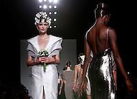 Modelle vestono le creazioni della collezione Autunno Inverno 2014/2015 di Sabrina Persechino durante la rassegna Altaroma, a Roma, 14 luglio 2014.<br /> Models wear creations by Sabrina Persechino Fall Winter 2014/2015 collection at the Altaroma fashion week in Rome, 14 July 2014.<br /> UPDATE IMAGES PRESS/Isabella Bonotto