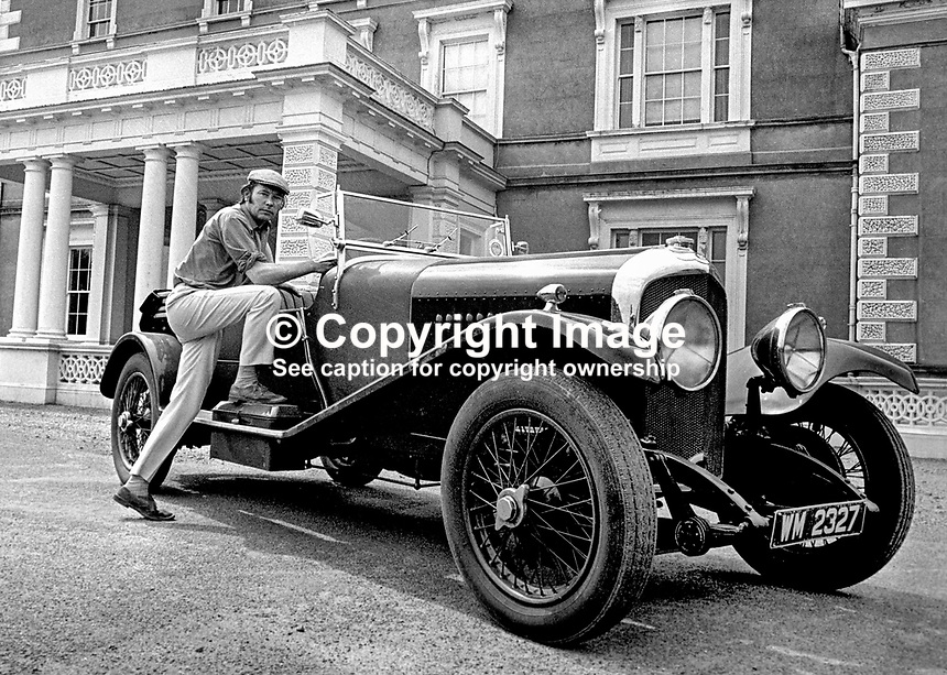 Henry Mulholland, 4th Lord Dunleath, Ballywalter, Co Down, N Ireland, at the wheel of an open-top Bentley in front of Ballywalter Park Mansion House. 197507000569c.<br /> <br /> Copyright Image from Victor Patterson, 54 Dorchester Park, Belfast, UK, BT9 6RJ<br /> <br /> t1: +44 28 9066 1296 (from Rep of Ireland 048 9066 1296)<br /> t2: +44 28 9002 2446 (from Rep of Ireland 048 9002 2446)<br /> m: +44 7802 353836<br /> <br /> e1: victorpatterson@me.com<br /> e2: victorpatterson@gmail.com<br /> <br /> The use of my copyright images is subject to my Terms &amp; Conditions.<br /> <br /> It is IMPORTANT that you familiarise yourself with them. They are available on my website at www.victorpatterson.com.<br /> <br /> None of my copyright images may be used on a website unless they are visibly watermarked, i.e. &copy; Victor Patterson within the body of the visible image. Metadata denoting my copyright must NOT be deleted. <br /> <br /> Web use is extra at currently recommended NUJ rates.