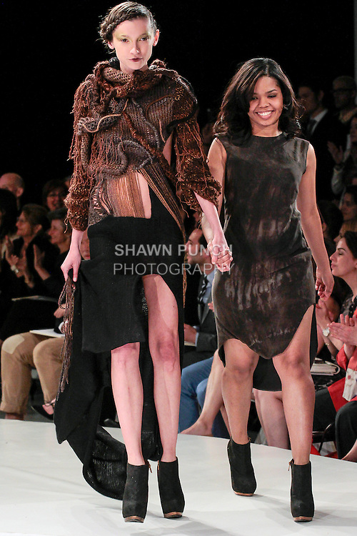 Graduating fashion student Paola Ricardo, walks runway with model at the close of the 2013 Pratt Institute Fashion Show, on April 25, 2013.