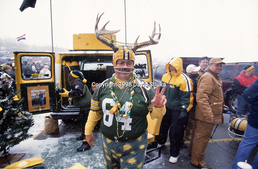 "Green Bay Packers fan Larry ""Packalope"" Primeau poses during a tailgate party before an NFL football game against the Tennessee Oilers at Lambeau Field on December 20,1998 in Green Bay, Wisconsin. The Packers won 30-22. In 1999, Larry ""Packalope"" Primeau was inducted into the NFL Hall of Fans. (Photo by David Stluka)"