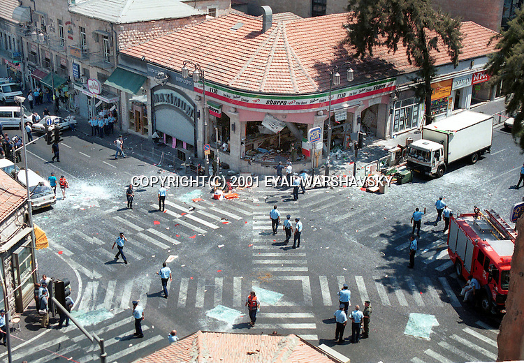 Israeli Police officers and bomb squad police stand near a Pizza Restaurant after a suicide bombing in Jerusalem  Thursdays Aug 9 2001. PHOTO BY Eyal Warshavsky