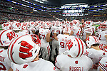 Wisconsin Badgers huddle prior to the Advocare Classic NCAA college football game against the Alabama Crimson Tide Saturday, September 5, 2015, in Arlington, Texas. The Crimson Tide beat the Badgers 35-17. (Photo by David Stluka)