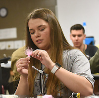 FROM FEATHERS TO FLY<br />Madison Burt, a student at Bentonville High School, puts the final touches on a fishing fly Wednesday March 11 2020 during a class taught by the Bella Vista Fly Tyers. Students in the high school's outdoor education class tied flies that they'll use on a trout-fishing field trip to Roaring River State Park in April. Students tied woolly bugger flies in a variety of colors with help from club members. Go to nwaonline.com/200312Daily/ to see more photos.<br />(NWA Democrat-Gazette/Flip Putthoff)
