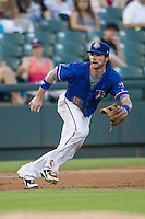 Round Rock Express third baseman Jason Donald (5) on defense during the Pacific Coast League baseball game against the Omaha Storm Chasers on June 1, 2014 at the Dell Diamond in Round Rock, Texas. The Express defeated the Storm Chasers 11-4. (Andrew Woolley/Four Seam Images)