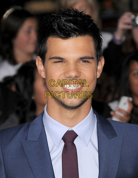 Taylor Lautner.The Los Angeles premiere of 'The Twilight Saga Breaking Dawn Part 1' at Nokia Theatre at L.A. Live in Los Angeles, California, USA..November 14th, 2011.headshot portrait blue purple tie stubble facial hair .CAP/RKE/DVS.©DVS/RockinExposures/Capital Pictures.