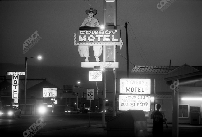 Route 66: Cowboy Motel, Wagon Wheel Motel and Sundown Motel signs at night, Amarillo, TX.