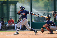 Infielder Elmer Reyes (13) of the Atlanta Braves farm system in a Minor League Spring Training intrasquad game on Wednesday, March 18, 2015, at the ESPN Wide World of Sports Complex in Lake Buena Vista, Florida. The catcher is Chris O'Dowd. (Tom Priddy/Four Seam Images)