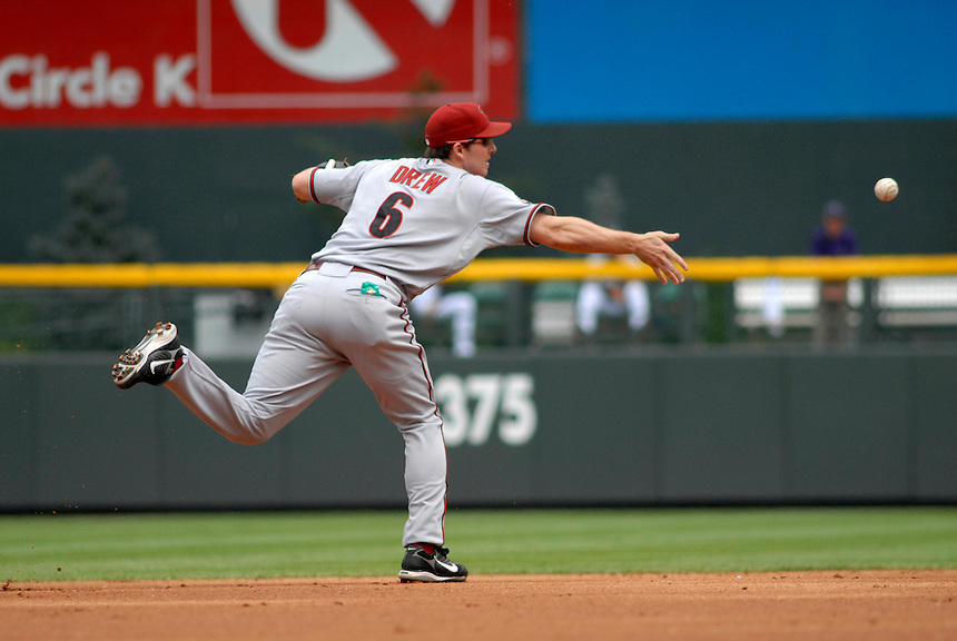 14 August 08: DBacks shortstop Stephen Drew flips the ball to the 2nd baseman on a 5-4-3 double play against the Colorado Rockies. The Arizona Diamondbacks defeated the Colorado Rockies 6-2 at Coors Field in Denver, Colorado. FOR EDITORIAL USE ONLY. FOR EDITORIAL USE ONLY