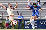 27 October 2013: Duke's Laura Weinberg (16) shoots past Pittsburgh's Morgan Sharick (25). The Duke University Blue Devils hosted the Pittsburgh University Panthers at Koskinen Stadium in Durham, NC in a 2013 NCAA Division I Women's Soccer match. Duke won the game 6-3.