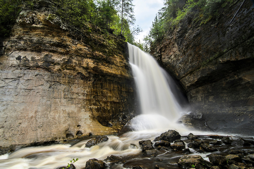 A unique view from below of the impressive Miners Falls in the Pictured Rocks National Lakeshore. Munising, MI