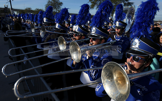 The Kentucky Wildcats marching band plays during the Cat Walk prior to the TaxSlayer Bowl against the Georgia Tech Yellow Jackets at EverBank Field on Saturday, December 31, 2016 in Jacksonville, Florida. Photo by Michael Reaves | Staff.