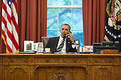 United States President Barack Obama talks with President Hassan Rouhani of Iran during a phone call in the Oval Office of the White House in Washington, D.C. on September 27, 2013. <br /> Mandatory Credit: Pete Souza - White House via CNP