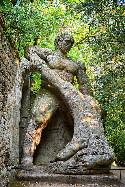 Wrestling Giants Staue, reprenting the battle of Hercules, good, and Caucus, evil, commissioned by Piaer Francesco Orsini c. 1513-84, The Renaissance Mannerist statues of the Park of Monsters or The Sacred Wood of Bamarzo, Italy