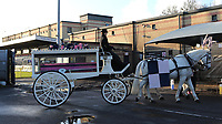 The horse and carriage carrying the coffin of Mishi stops in the car park alongside the entrance to the ground during the funeral of Dulwich Hamlet FC supporter Mishi Morath at Champion Hill Stadium on 15th January 2020