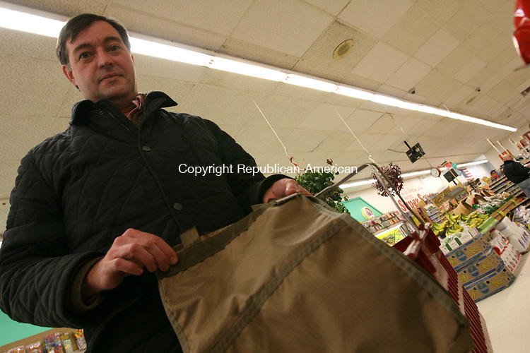 WINSTED, CT - 27 January, 2009 - 012709MO05 - Barry Webber, 45, of Norfolk has been using reusable bags for about a year, and would fully support a move by the state to reduce or eliminate plastic shopping bags. Jim Moore Republican-American.