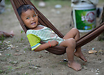 A boy sits in a hammock in the village of Phar Thruey in northern Cambodia.