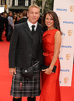 Chris Hoy and wife arriving for the BAFTA Television Awards 2010 at the London Palladium. 06/06/2010  Picture by: Steve Vas / Featureflash