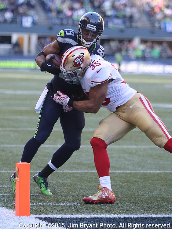 Seattle Seahawks wide receiver Doug Baldwin (89) is knocked out of bounds by San Francisco 49ers defensive back  Eric Reid (35) on the two yard line at CenturyLink Field in Seattle, Washington on November 22, 2015.  The Seahawks beat the 49ers 29-13.   ©2015. Jim Bryant Photo. All RIghts Reserved.