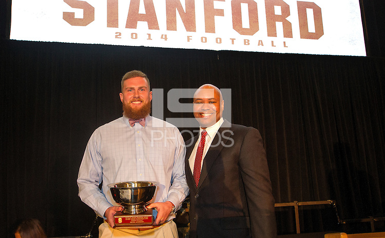 STANFORD, CA - DECEMBER 7, 2014--(L-R) Henry Anderson  co Valuable Football Player 2014, with Stanford Football coach David Shaw, during the Football team banquet.