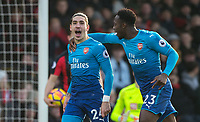 Hector Bellerin of Arsenal celebrates scoring the opening goal of the match during the Premier League match between Bournemouth and Arsenal at the Goldsands Stadium, Bournemouth, England on 14 January 2018. Photo by Andy Rowland.