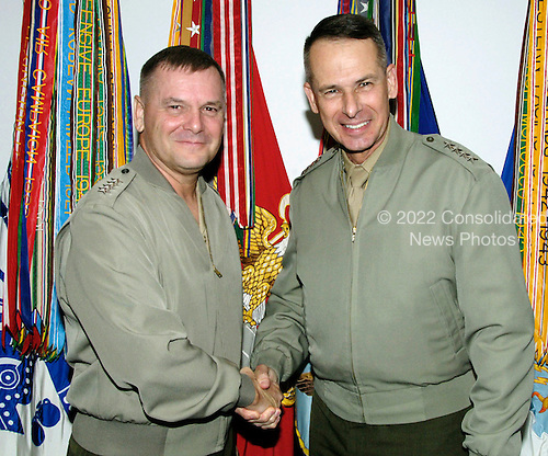 United States Marine Corps General Peter Pace, right, Chairman of the Joint Chiefs of Staff, shakes hands with U.S. Marine Corps General James Cartwright, vice chairman of the Joint Chiefs of Staff. General Cartwright began his duties as vice chairman by meeting with the chairman in his office Aug. 6, 2007.  Cartwright is a target of a Justice Department investigation into a leak of information about a covert U.S.-Israeli cyberattack on Iran&rsquo;s nuclear program.  <br /> Mandatory Credit: Mamie Burke / DoD via CNP