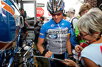 Tom Danielson of the Discovery Channel Pro Cycling Team signs autographs before Stage 2 of the 2006 Ford Tour de Georgia pro cycling race. Yaroslav Popovych, a Discovery Channel Pro Cycling Team racer from Ukraine, won the 116.1-mile stage from Fayetteville to Rome in 4:47:39.<br />