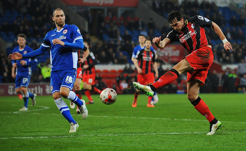 Bournemouth's Charlie Daniels under pressure from Cardiff City's Matthew Connolly<br /> <br /> Photographer Kevin Barnes/CameraSport<br /> <br /> Football - The Football League Sky Bet Championship - Cardiff v Bournemouth - Tuesday 17th March 2015 - Cardiff City Stadium - Cardiff<br /> <br /> &copy; CameraSport - 43 Linden Ave. Countesthorpe. Leicester. England. LE8 5PG - Tel: +44 (0) 116 277 4147 - admin@camerasport.com - www.camerasport.com